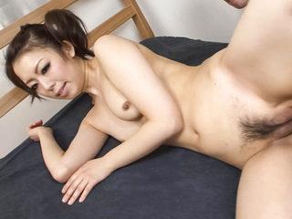 Yuki Asami in pig-tails takes on two cocks sucking them..